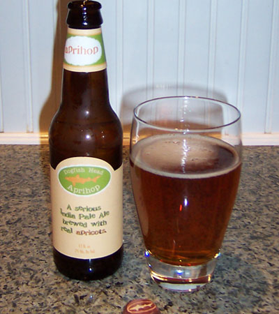 Bottle and fresh glass of Dogfish Head ApriHop