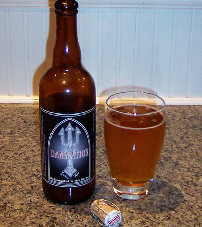 Bottle and fresh glass of Russian River Brewing Damnation (batch 32)