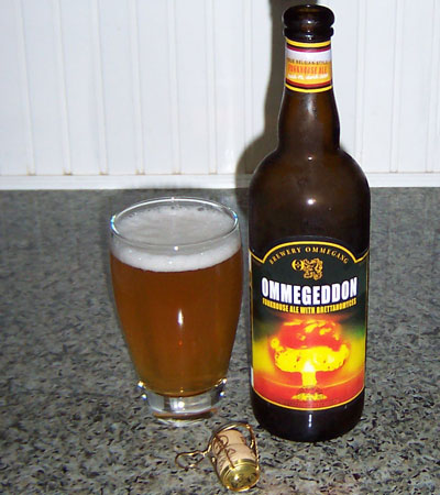 Bottle and fresh glass of Brewery Ommegang Ommegeddon